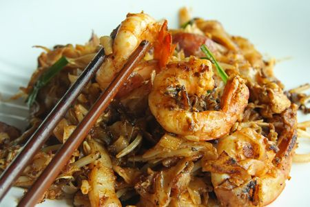 Fried flat rice noodles traditional chinese malaysian cuisine photo
