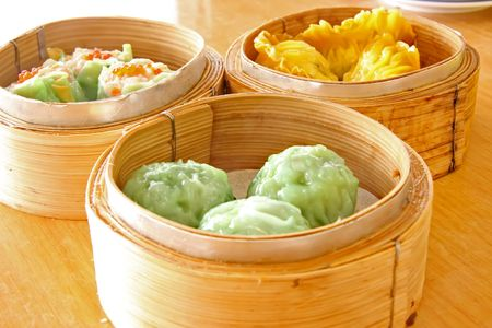 Chinese steamed dimsum in bamboo containers traditional cuisine Stock Photo - 3210801