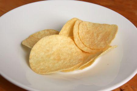 seasoned: Fried potato chip snack food in white plate