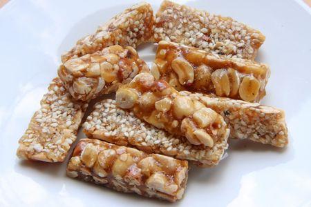 brittle: Peanut brittle sweet hard nut snack crunchy pieces Stock Photo
