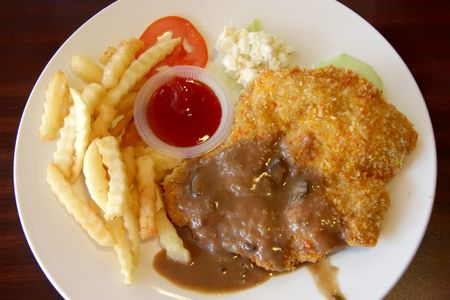 breaded: Breaded fried chicken chop with french fries and gravy Stock Photo