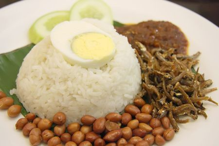 Nasi lemak traditional malaysian spicy rice dish photo