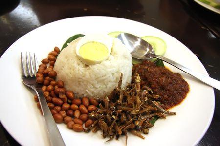 Nasi lemak traditional malaysian spicy rice dish Stock Photo - 3271913