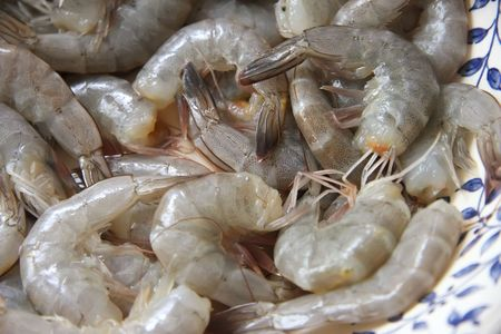 Closeup of whole raw prawns in shells without head photo