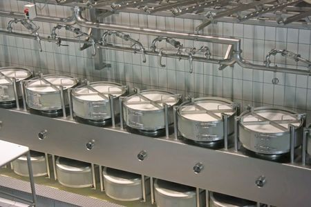 food storage: Interior of a cheese factory with modern equipment Stock Photo