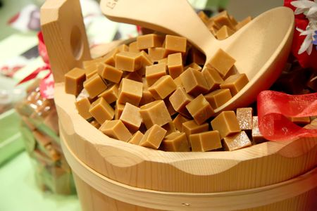 confectionary: Caramel cubes in wooden bucket fancy confectionary presentation