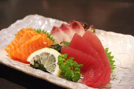 seafood platter: Arrangement of sashimi sliced raw japanese fish dish