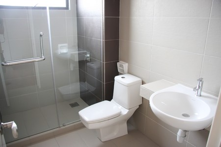 fixtures: Modern clean toilet bathroom interior with white porcelain Stock Photo