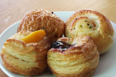 puff: Several sweet puff pastries with fruit decoration