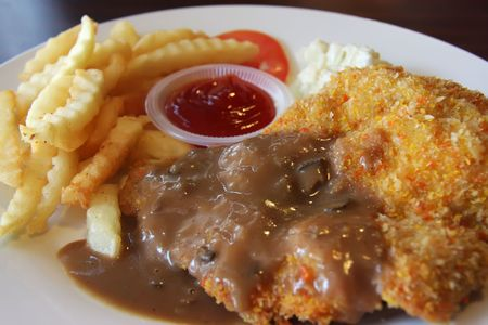 Fresh golden fried chicken chop with french fries photo