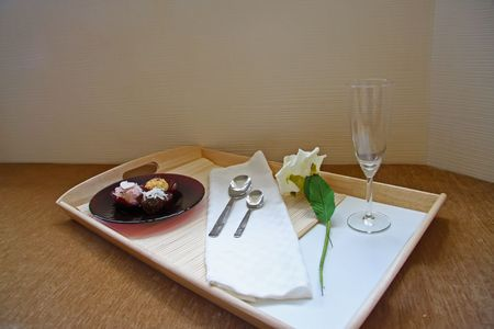 Fancy chocolate truffles served in elegant setting photo