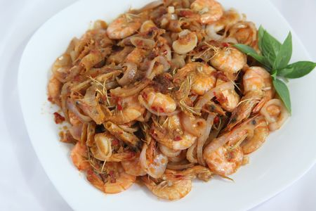 Spicy asian prawns traditional ethnic cuisine on plate photo
