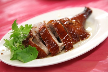 Chinese asian roast duck whole leg serving Stock Photo