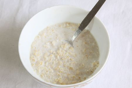 soggy: Bowl of rolled oats soaked in milk, breakfast cereal