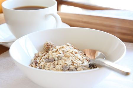 Elegant breakfast on tray with cereal grains and coffee photo