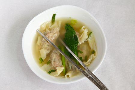Traditional Chinese wonton stuffed meat dumpling soup photo