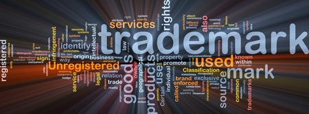 business law: Background concept wordcloud illustration of  trademark glowing light