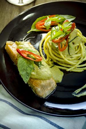 Spaghetti and green curry sauce salmon Stock Photo