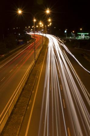 light trail: Rastros de luz en el camino Foto de archivo