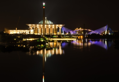 Putrajaya view from putrajaya bridge at night with a reflection of water. photo