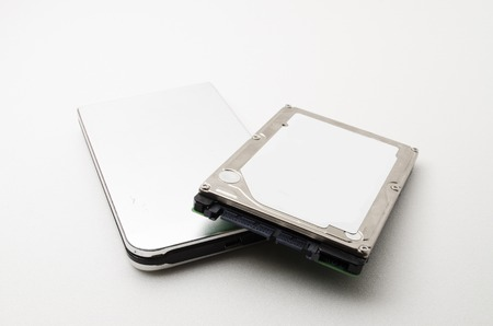 external hard disk drive: Laptop Hard Disk Drive with external casing. All information about the hard disk was removed. Focus on the closes distance. Stock Photo