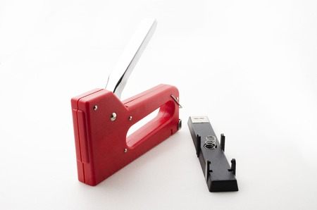 office stapler: Red Stapler Gun.shoot on white background. Useful for office and household. Manage and combine document.