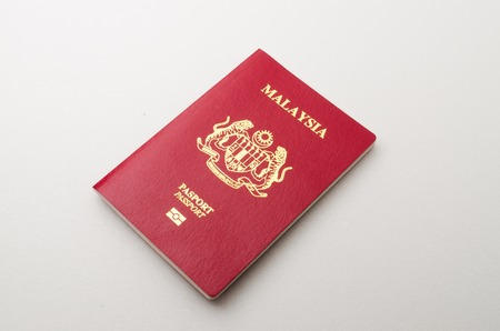 Kedah, Malaysia - February 5, 2015 : Malaysian Passport. Malaysian passport is an international pass to cross over another country. A person with a passport can stay on any country as long as the passport is not expired.