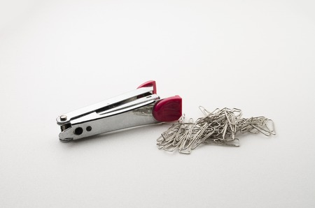 staplers: Stapler and Paper Clip. The binder and paper organizer. Focus on the closes distance. Stock Photo