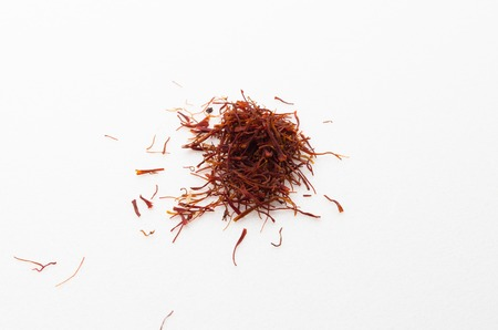 safran: Safron is a valuable herbs mostly found in arabic country. Saffron has many benefits towards health.By mixing a few saffron with hot water, the water will turn color into yellow. Stock Photo