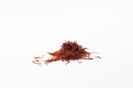 Safron is a valuable herbs mostly found in arabic country. Saffron has many benefits towards health.By mixing a few saffron with hot water, the water will turn color into yellow. photo