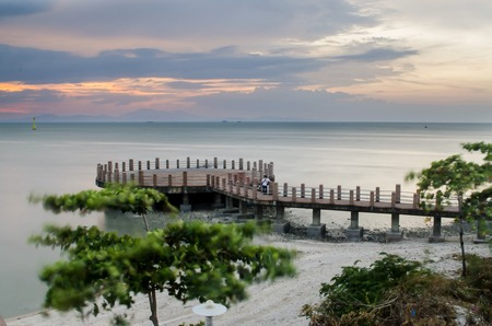 Sea Jetty for viewing sunset.  This is a beautiful places for tourist. There is a  mosque nearby called Floating Mosque. Loxated in Perlis Malaysia.  Contain Normal noise since shoot using slow shutter.