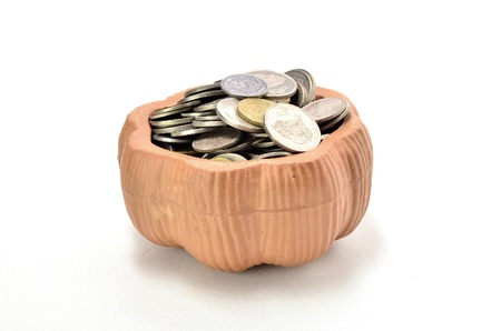 holiday profits: Clay Container with Malaysian Coin. shoot over white background. Produced by using clay materials and burned until it harden. Multipurpose use. Focus on the important part. Shallow depth of field.