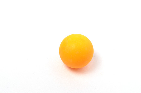 Yellow table tennis Ball. SHoot over white background. Focus on the closes distance. Shallow depth of field.