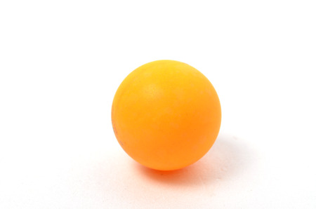 Yellow Ping Pong Ball. SHoot over white background. Focus on the closes distance. Shallow depth of field.