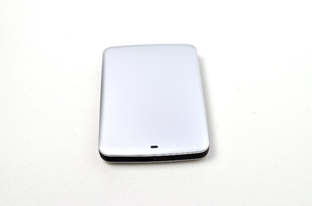 External Hard disk. Shoot over white background. Focus on the important part. Shallow depth of field. Stock Photo