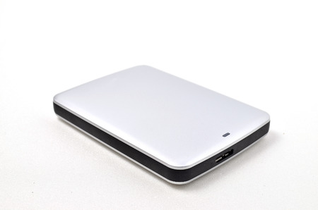 gigabytes: External Hard disk. Shoot over white background. Focus on the important part. Shallow depth of field. Stock Photo