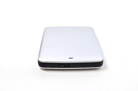 External Hard disk. Shoot over white background. Focus on the important part. Shallow depth of field. photo