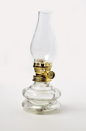 Oil Lamp. Shoot over white background. Focus on the important part. Shallow depth of field. Stock Photo