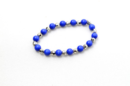 Blue Bracelet. Shoot over white background. Focus on the important part. Shallow depth of field.
