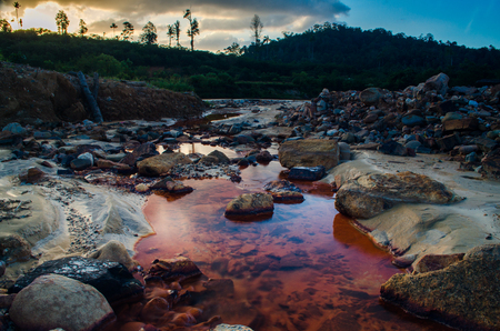 Red River caused by rusted steel Stock Photo