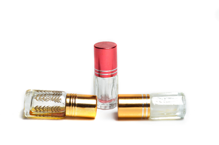 Perfume in small bottle with white background