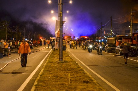 Kedah, Malaysia - March 8, 2015 : A supermarket was burned terribly and almost 10 Fireman vehicle come to resque and stop the fire. The water was supplied from one kilometre away by Fireman Hose.