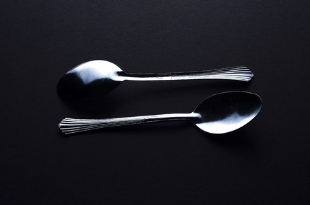 side lighting: Spoon with side lighting giving a look of shadow and highlight Stock Photo