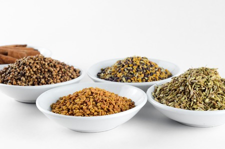 asian flavors: Mixed spice in bowl over white background Stock Photo