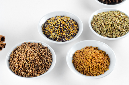 Mixed spice in bowl over white background Stock Photo