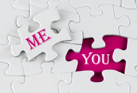 White puzzle with void in the middle when one piece of the puzzle is taken out with text written You and Me