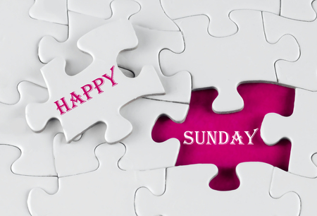 White puzzle with void in the middle when one piece of the puzzle is taken out with text written Happy Sunday
