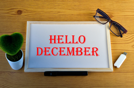 Business Concept - Office desk with equipment and text written Hello December