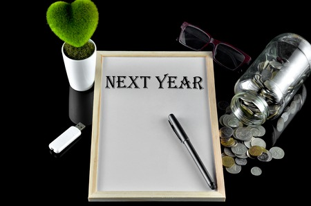 next year: Business concept - Office table with equipment and text written Next Year