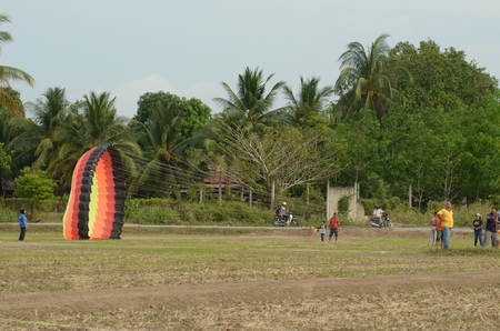 challange: Perlis, Malaysia - March 05, 2017: Perlis East Wind Carnival was a yearly event of Perlis. Consist of food booth, game, challange, contest, and fun park. Contestant Playing Kite or called Wau Editorial